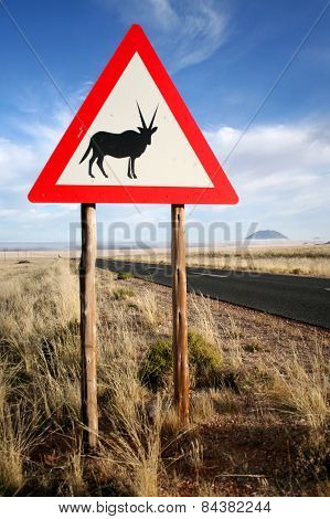 A caution Oryx sign sits on the road side in Namibia