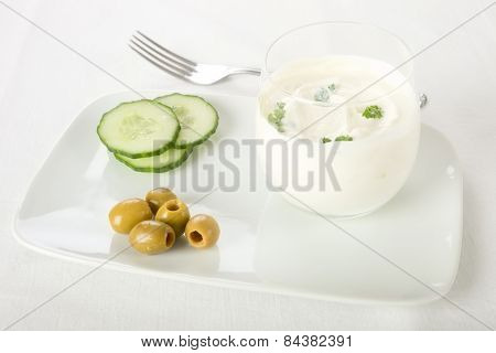 Cream cheese, cucumber and olives.
