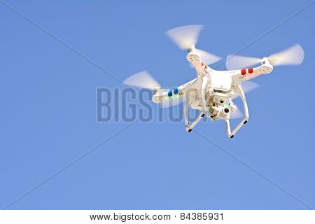 Drone Hovers Isolated Against Blue Sky