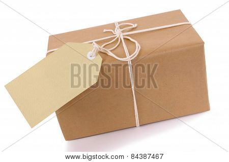 Brown Paper Package With White String And Tag