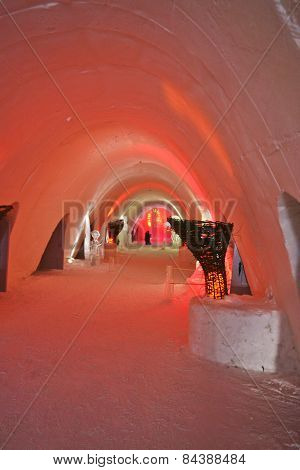 Colorfully Illuminated Corridor In An Ice Hotel.