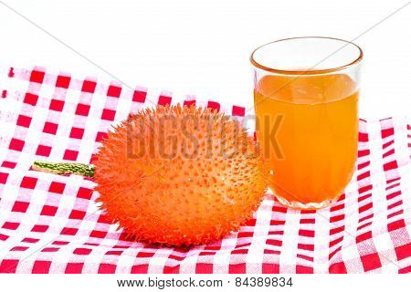 Gac Fruit And Juice Isolated On White.