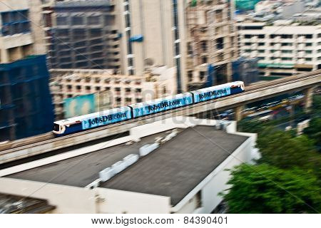 Sky Train In Motion Between Station Nana And Ashoka