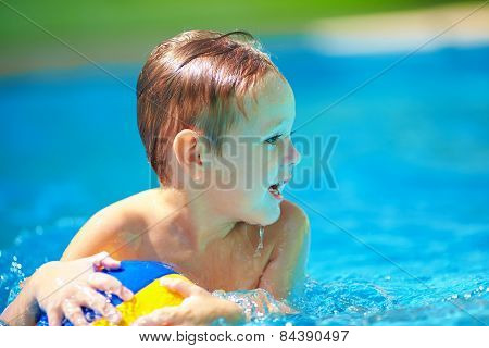 Cute Kid Playing In Water Sport Games In Pool