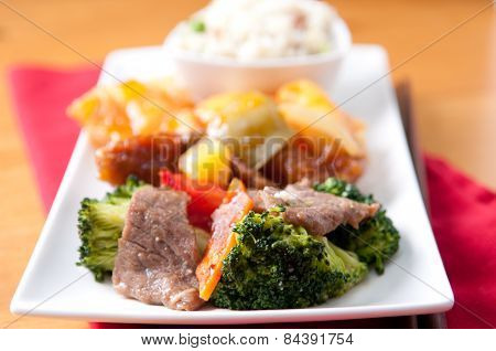 Tasty Chinese Food With Fried Rice, Beef, Chicken And Fresh Vegetables