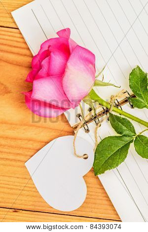 Pink Rose And Diary With Empty Tag