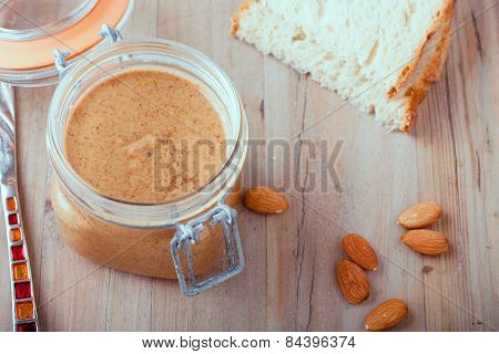 Raw Organic Almond Butter on a Background