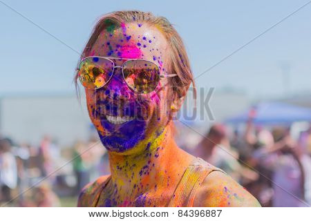 Unknown Man With Painted Face Wearing Glasses And Smiling During