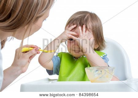 Child boy refuses to eat closing face by hands