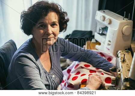 Middle Aged Woman Sewing