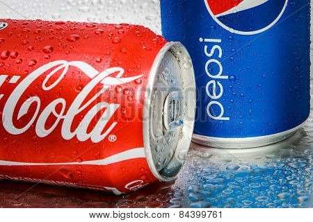 SABAH, MALAYSIA - March 08, 2015: Coca-Cola and Pepsi cans on metal background.