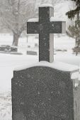 picture of tombstone  - snow covered tombstone with cross in cemetary - JPG