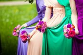 image of bouquet  - Bridesmaids in colorful dresses with bouquets of flowers - JPG