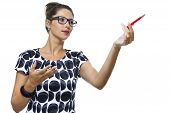 image of ballpoint  - Portrait of Serious Woman with Eyeglasses Wearing a Printed Dress Holding a Red Ballpoint Pen - JPG