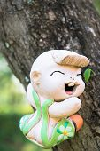 picture of molding clay  - smile baked clay dolls in the garden - JPG