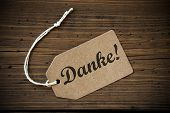 foto of thankful  - Close Up Of A Brown Label With White Ribbon On Wooden Background With German Text Danke Which Means Thank You Frame And Vintage Or Retro Style - JPG