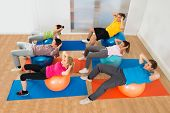 stock photo of pilates  - High Angle View Of People Exercising On Pilate Ball - JPG
