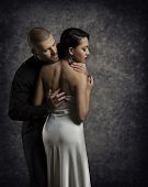 image of boys night out  - Couple Portrait Man Woman in Love Boy in Dark Embracing Elegant Sexy Girl in Gown with Naked Back - JPG