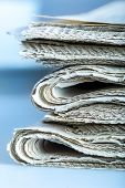 picture of newspaper  - Newspapers folded and stacked concept for global communications - JPG