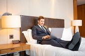 stock photo of adults only  - Working in hotel room - JPG