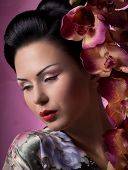 stock photo of geisha  - Portrait of a Japanese geisha young beautiful woman - JPG