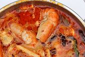 foto of thai cuisine  - Tom Yum Goong - Thai hot and spicy soup with shrimp - Thai Cuisine ** Note: Soft Focus at 100%, best at smaller sizes - JPG