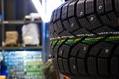 picture of stud  - New modern studded winter tires on the shelf in the store  - JPG