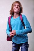 foto of leaping  - Portrait of a schoolchild with backpack leaping  - JPG