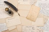 stock photo of nostalgic  - Old letters vintage postcards and antique feather pen - JPG