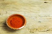stock photo of cayenne pepper  - Cayenne Pepper in the bowl on wooden table - JPG