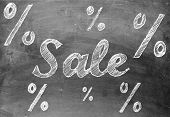 picture of prosperity sign  - Sale chalk writing with percentage signs on old vintage black chalkboard - JPG