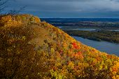 picture of bluff  - a glowing sunlit miississippi river bluff lumes over the miississippi river in riverbluff state park minnesota autumn - JPG