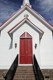 image of red siding  - Entrance to country church with with siding and red doors - JPG