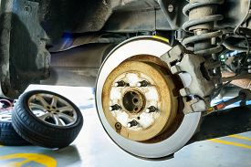 stock photo of truck-stop  - Close Up Of Disk Brake On Car In Process Of Damaged - JPG