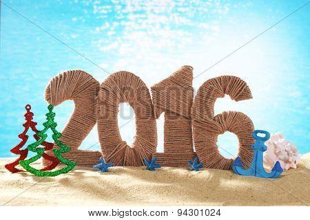 New year 2016 sign on beach sand