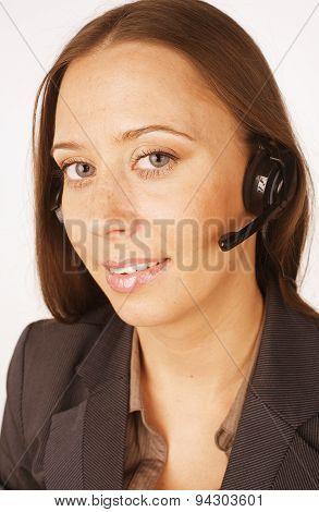 young happy girl call operator in headphones