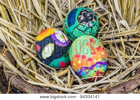 Easter Eggs With Bright Drawing In A Nest From A Dry Grass
