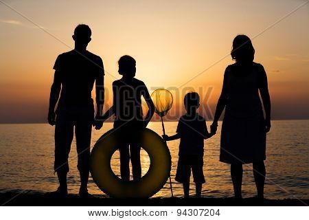 Silhouette of family at the beach.