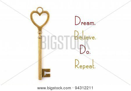 Gold Heart Shape Key With Inspirational Phrase.