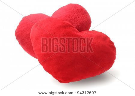 Two Red Heart Cushions on White Background