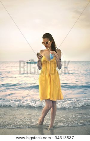 Girl dressed in yellow sending text messages