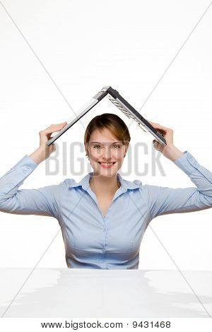 Young Businesswoman Holding A Laptop Above Her Head