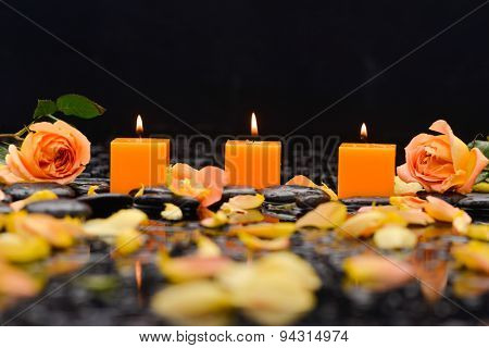 rose ,petals with candle and therapy stones