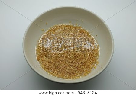 Minced garlic and oil in dish
