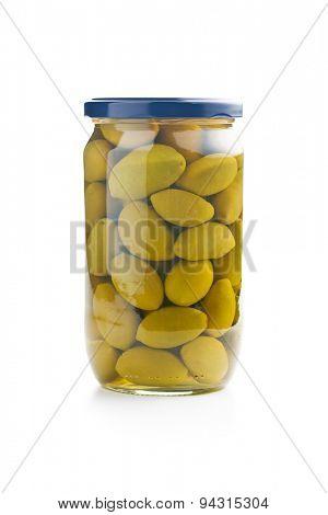 green olives in jar on white background