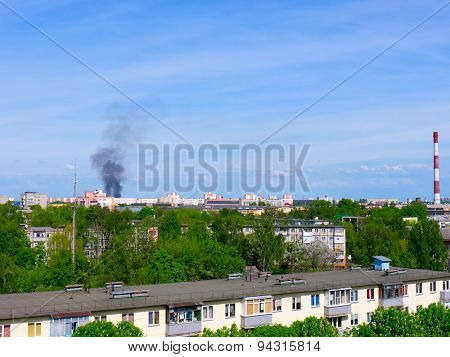 Factory chimneys and smoke.