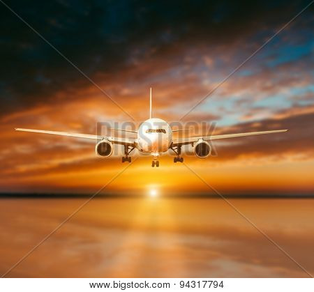 plane lands on the runway on a background of gorgeous sunsets