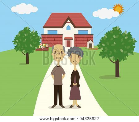 Senior Couple Standing In Front Of Their House