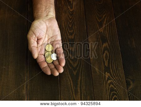 Coins in a man's hand