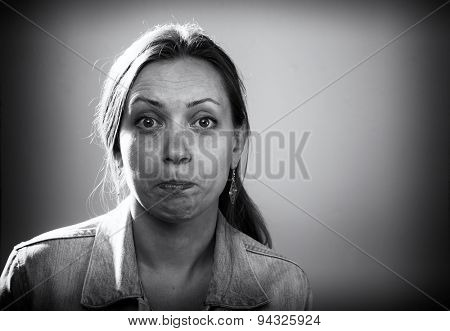 An unpleasant surprise. Concept photo. Black and white portrait of a young woman